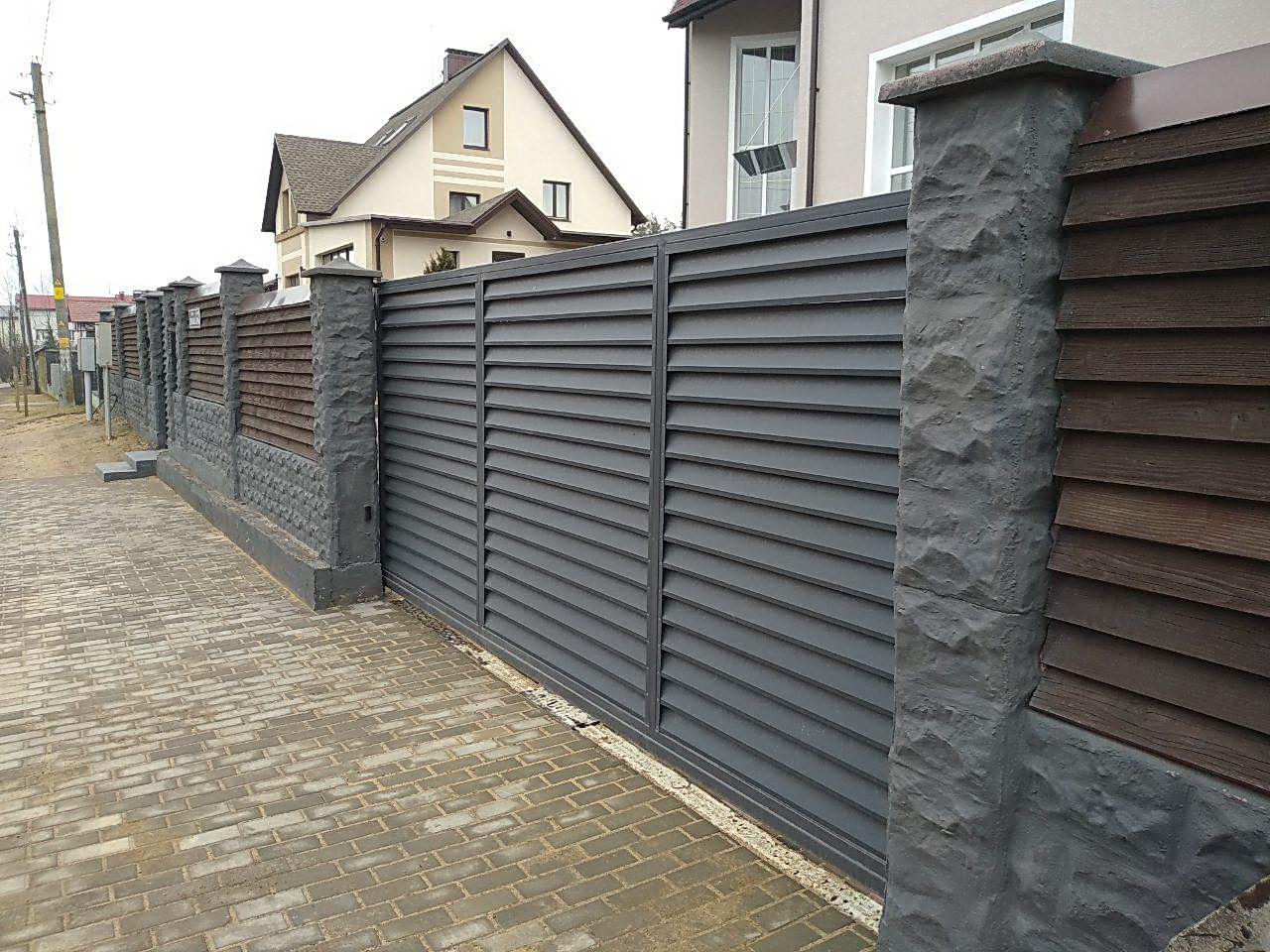 забор рваный камень черный